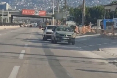 Bursa'da bozulan otomobili kara yolunda ters çekti